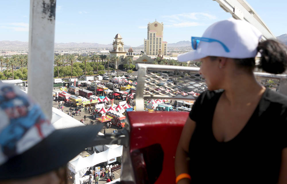 Erika Scott rides the Ferris wheel overlooking the Great American Foodie Fest at the Sunset Station in Henderson, Sunday, Oct.1, 2017. Elizabeth Brumely Las Vegas Review-Journal