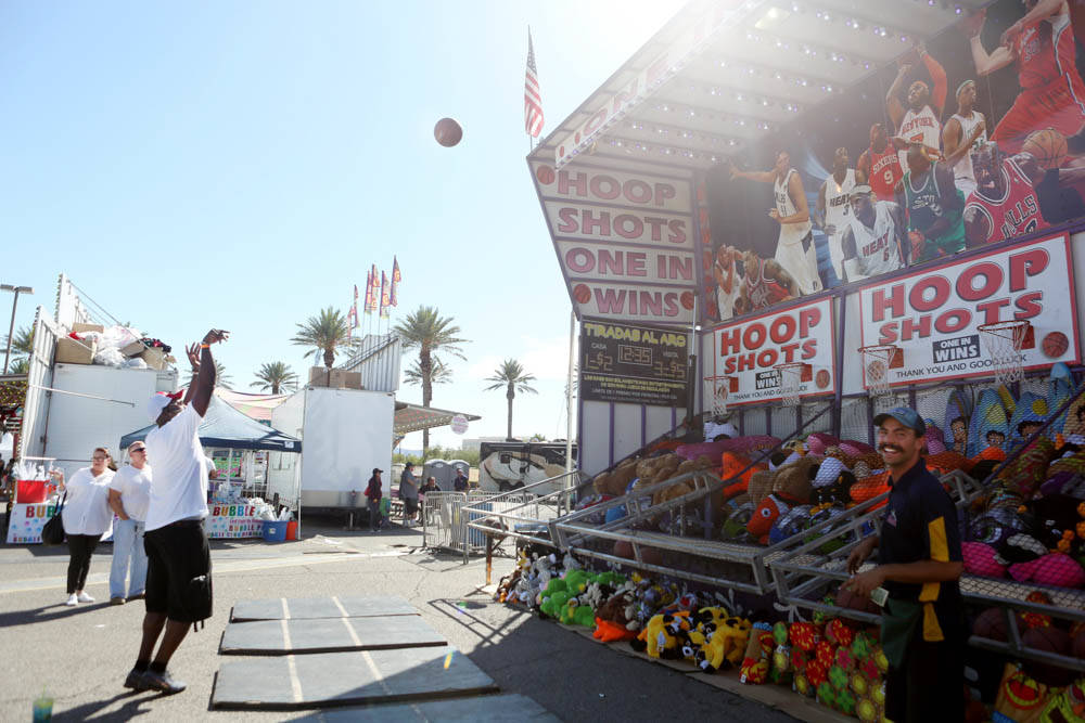Visitors of the Great American Foodie Fest play a carnival game at the festival at the Sunset Station in Henderson, Sunday, Oct.1, 2017. Elizabeth Brumely Las Vegas Review-Journal