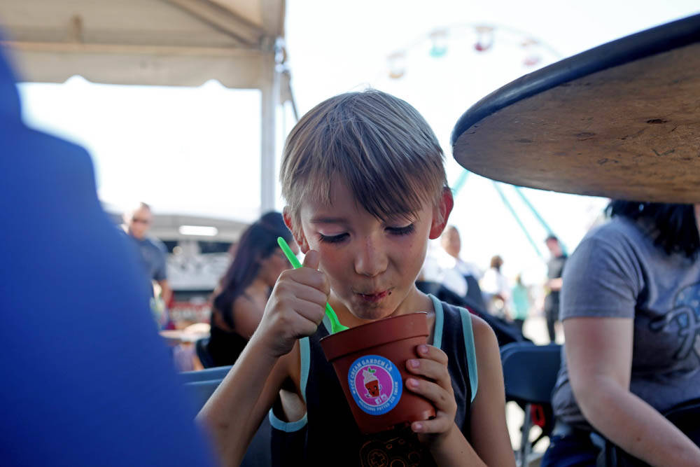 Lloyd Webster-Parks, 7, eats a dirt cup from the vendor, Ice Cream Garden LA, at the Great American Foodie Fest at the Sunset Station in Henderson, Sunday, Oct.1, 2017. Elizabeth Brumely Las Vegas ...