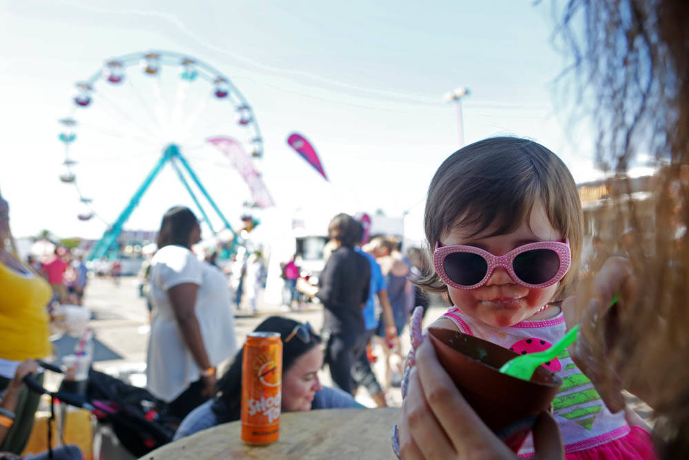 Lyric, 1, whose parents don't want to publish her last name, eats a dirt cup from the vendor, Ice Cream Garden LA, at the Great American Foodie Fest at the Sunset Station in Henderson, Sunday, Oct ...