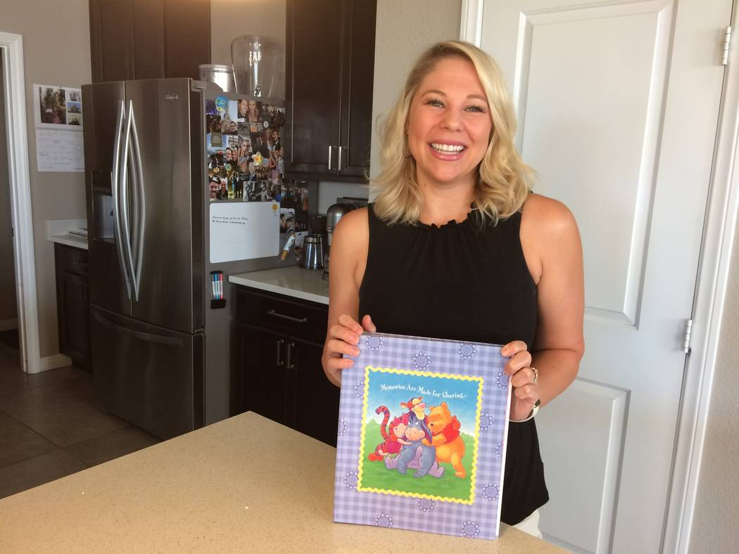 Amanda Klein holds a memory book that honors her mother Sept. 1, 2017, at her Summerlin home. Her mother was diagnosed with breast cancer twice and died from it in 2009. Now, Klein is a  board mem ...