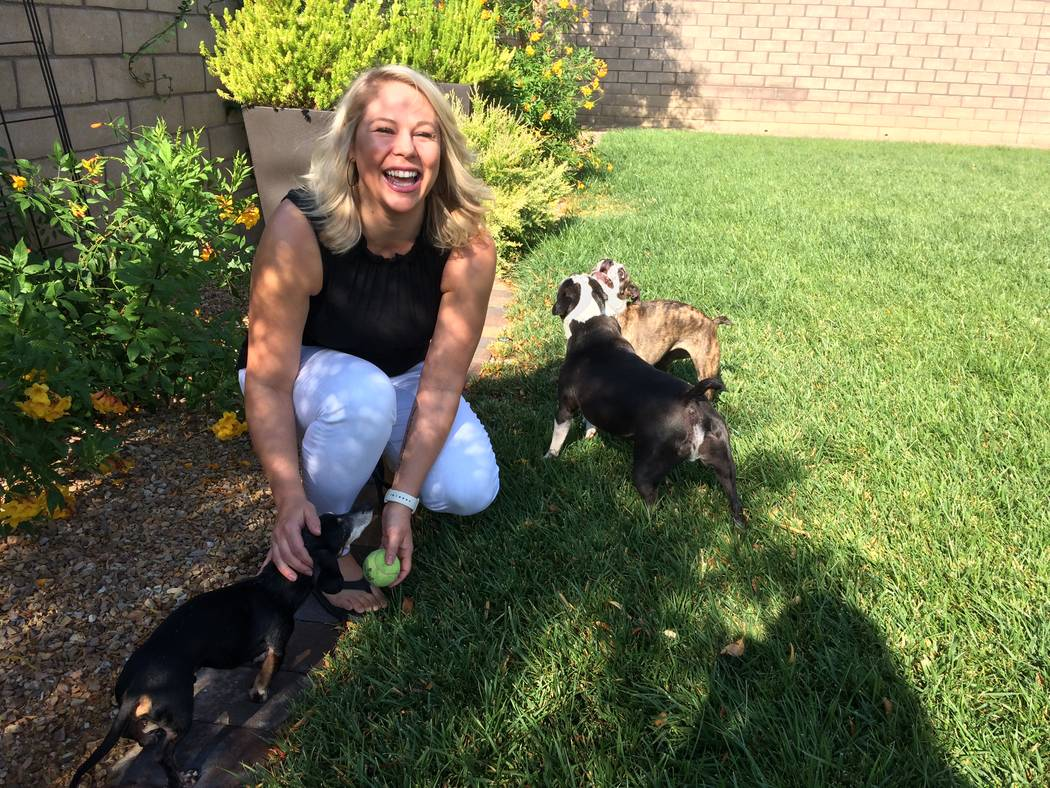 Amanda Klein plays with her dogs Sept. 1, 2017, in the backyard of her Summerlin home. Her mother was diagnosed with breast cancer twice and died from it in 2009. Now, Klein is a  board member of  ...
