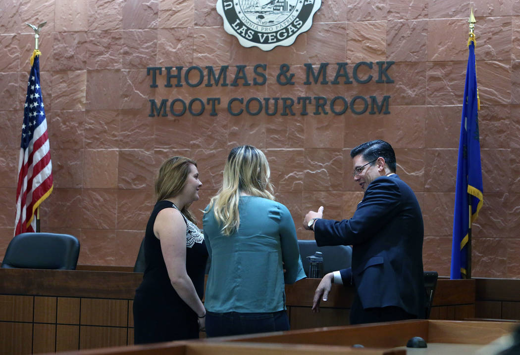 Olivia Campbell, left, Bailey Kara, center, and Jason Mitchell, director of the Trial Advocacy Program, and coach of the UNLV Criminal Justice Mock Trial Team, discuss prior to the start of a Mock ...
