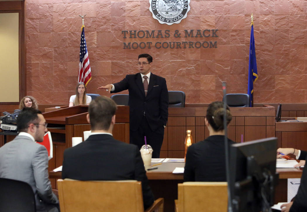 Jason Mitchell, director of the Trial Advocacy Program, and coach of the UNLV Criminal Justice Mock Trial Team, delivers instructions before a Mock Trial competition on Thursday, Sept. 29, 2017 at ...