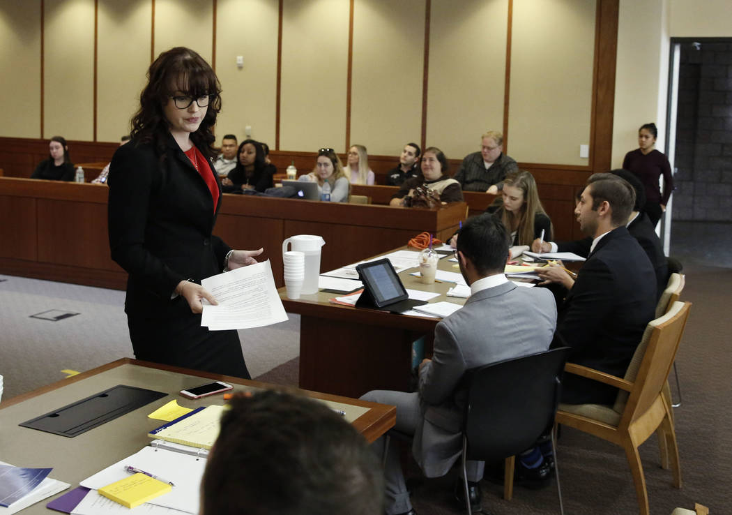 Julia Barker, defense attorney, gets back to her seat after delivering the opening statement during a Mock Trial competition on Thursday, Sept. 29, 2017 at Thomas and Mack Moot Court in Las Vegas. ...