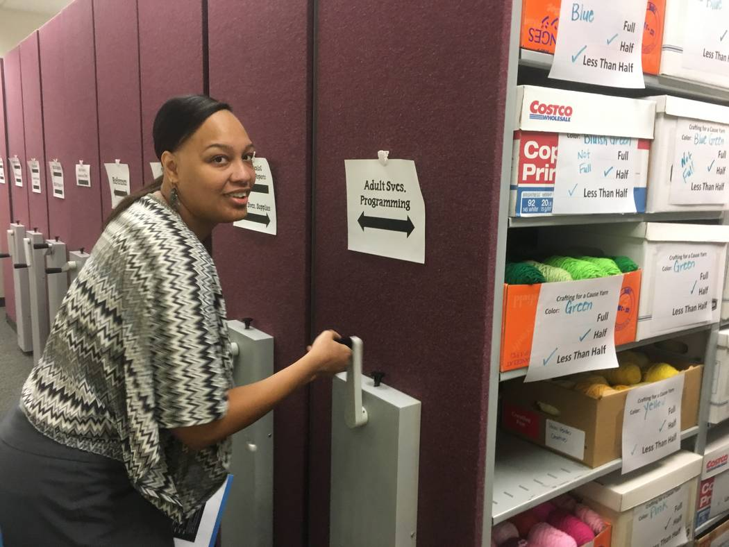 Gibson librarian Shakita Kirkland moves cabinets around to unveil the library's huge amounts of donated yarn for the Crafting for a Cause program. (Diego Mendoza-Moyers/View) @dmendozamoyers