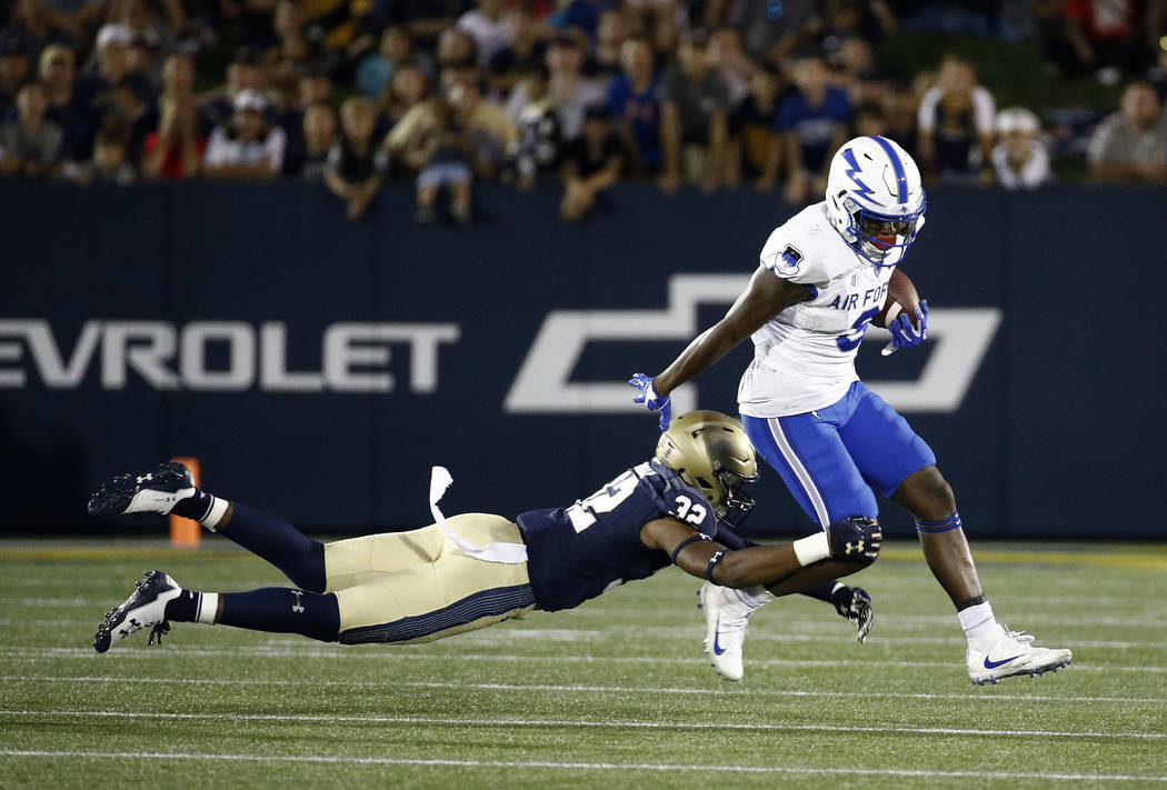 Air Force wide receiver Ronald Cleveland, right, rushes past Navy cornerback Micah Farrar in the second half of an NCAA college football game in Annapolis, Md., Saturday, Oct. 7, 2017. (AP Photo/P ...