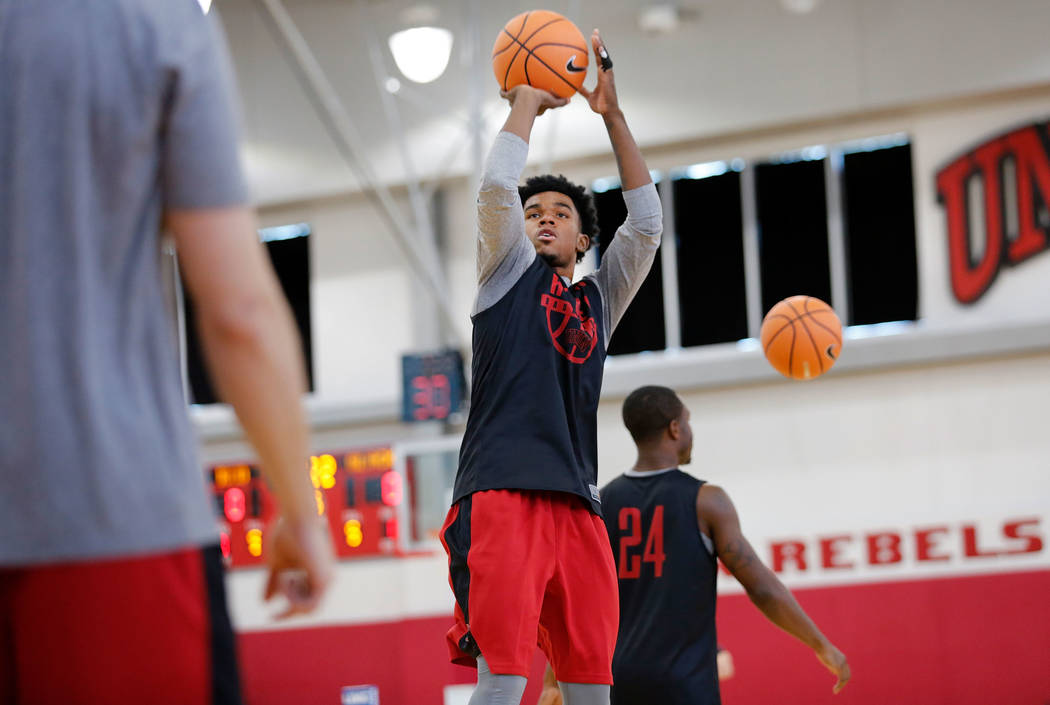 UNLV basketball player Jovan Mooring, center, shoots the ball in the hoop during their practice at the Mendenhall Center in Las Vegas, Saturday, Sept. 30, 2017. Chitose Suzuki Las Vegas Review-Jou ...