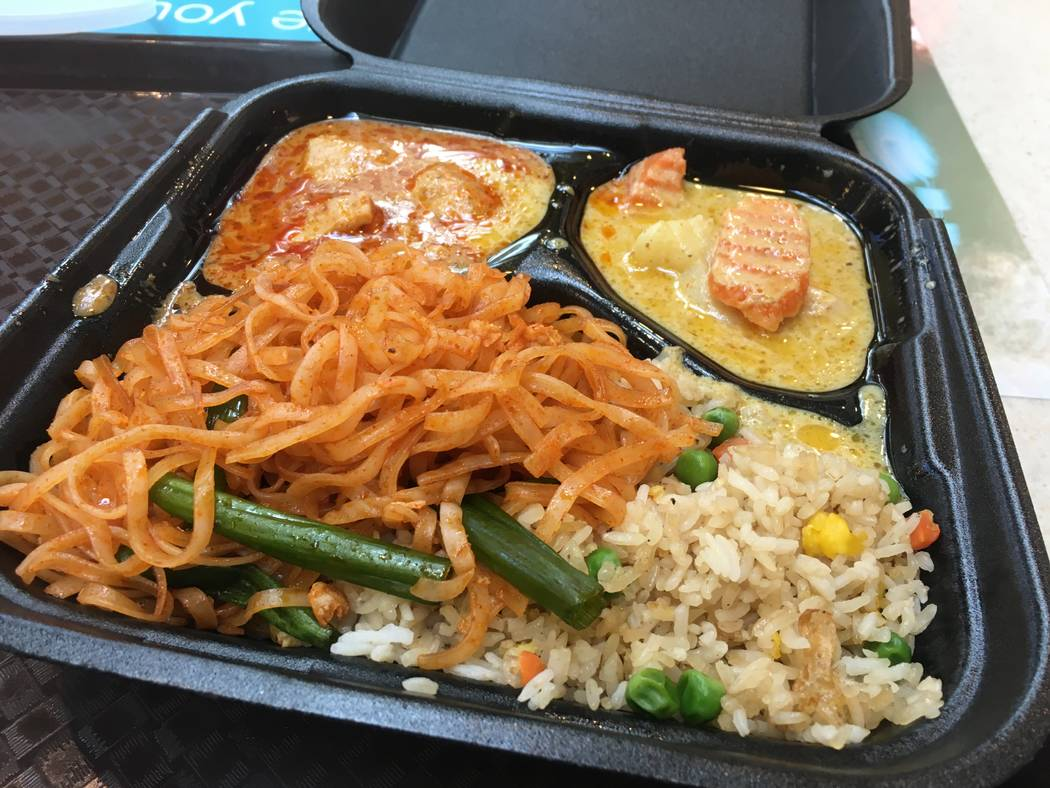The pad thai and fried rice served with yellow curry (top right), as well as the panang curry (top left), a spicy option manager Jason Sugai typically warns unsuspecting customers about. (Diego Me ...