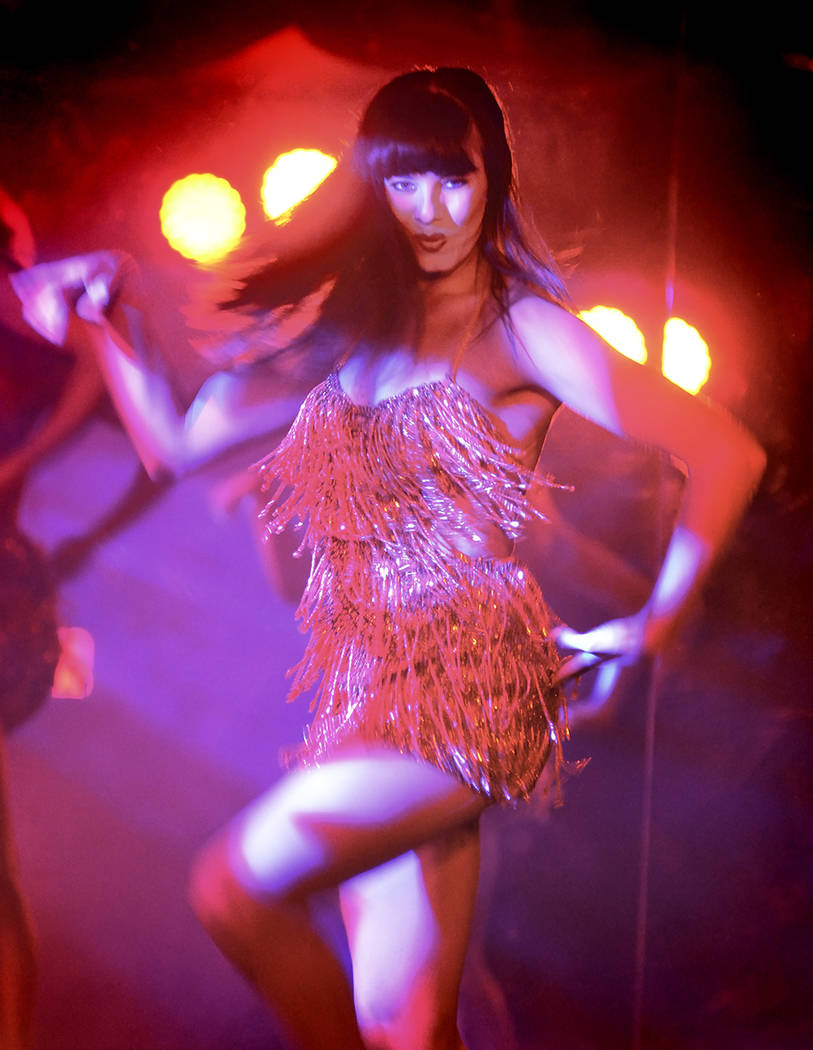 """A """"Crazy Girls"""" dancer performs in the show at Sin City Theater in Planet Hollywood. (Bill Hughes)"""