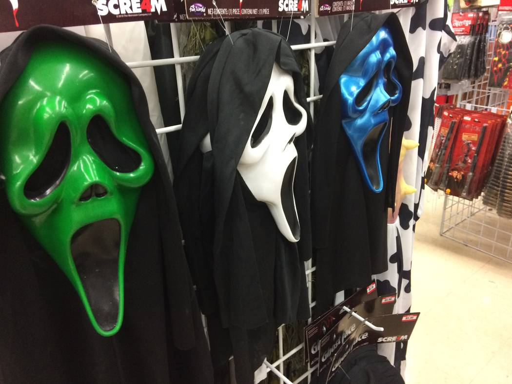 Halloween masks are seen Sept. 26, 2017, at Savers, 8530 W. Lake Mead Blvd., is seen Sept. 26, 2017. A new poll shows that Americans will spend roughly $87 per person on the holiday, but many will ...