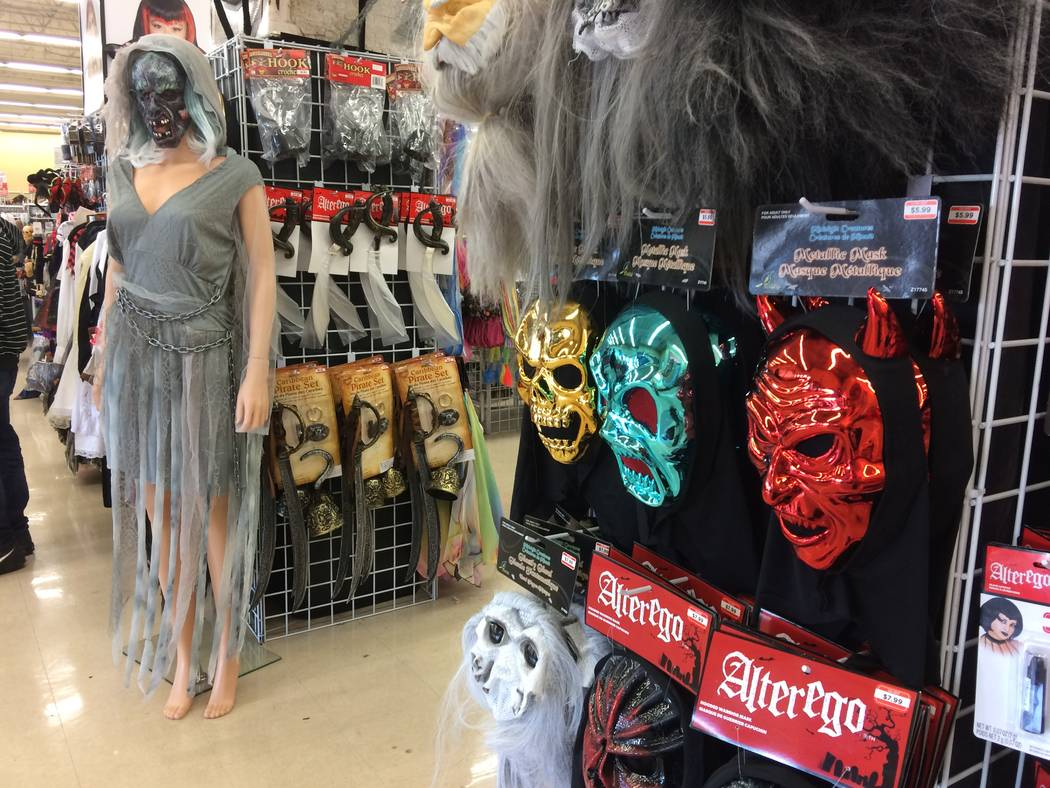 A mannequin, seen Sept. 26, 2017,  is decked out in a DIY outfit at Savers, 8530 W. Lake Mead Blvd. Signs claim: Treasures for less. A new poll by the National Retail Federation reports that two-t ...