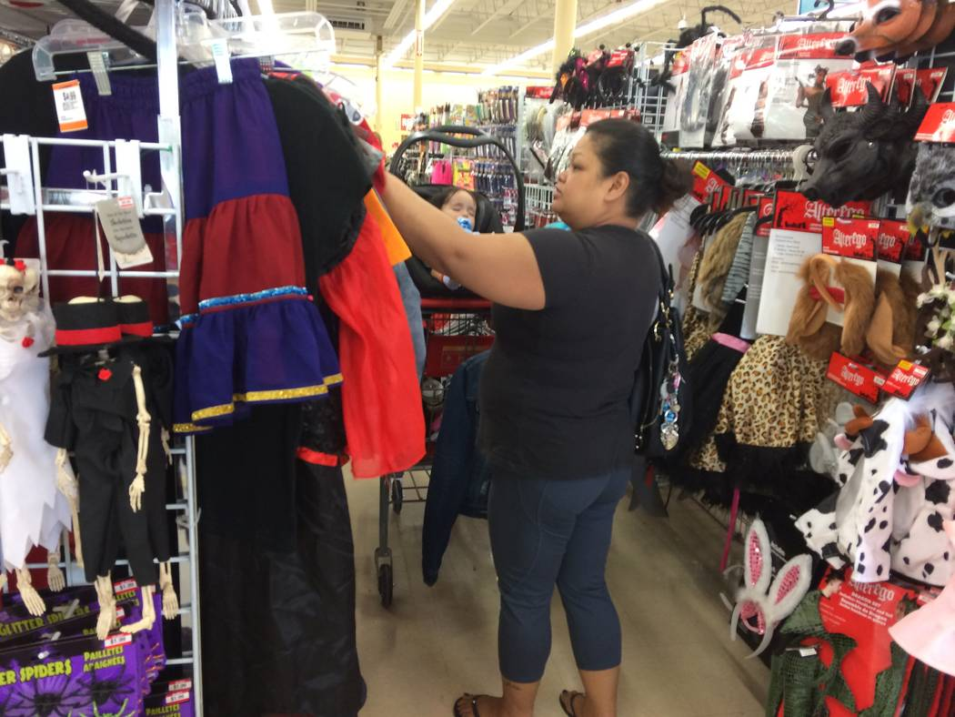 """Jolene McGlory shops at Savers, 8530 W. Lake Mead Blvd., on Sept. 26, 2017. She has three children plus she'll buy costumes for her nieces. How big is the holiday at her house? """"We're Christ ..."""