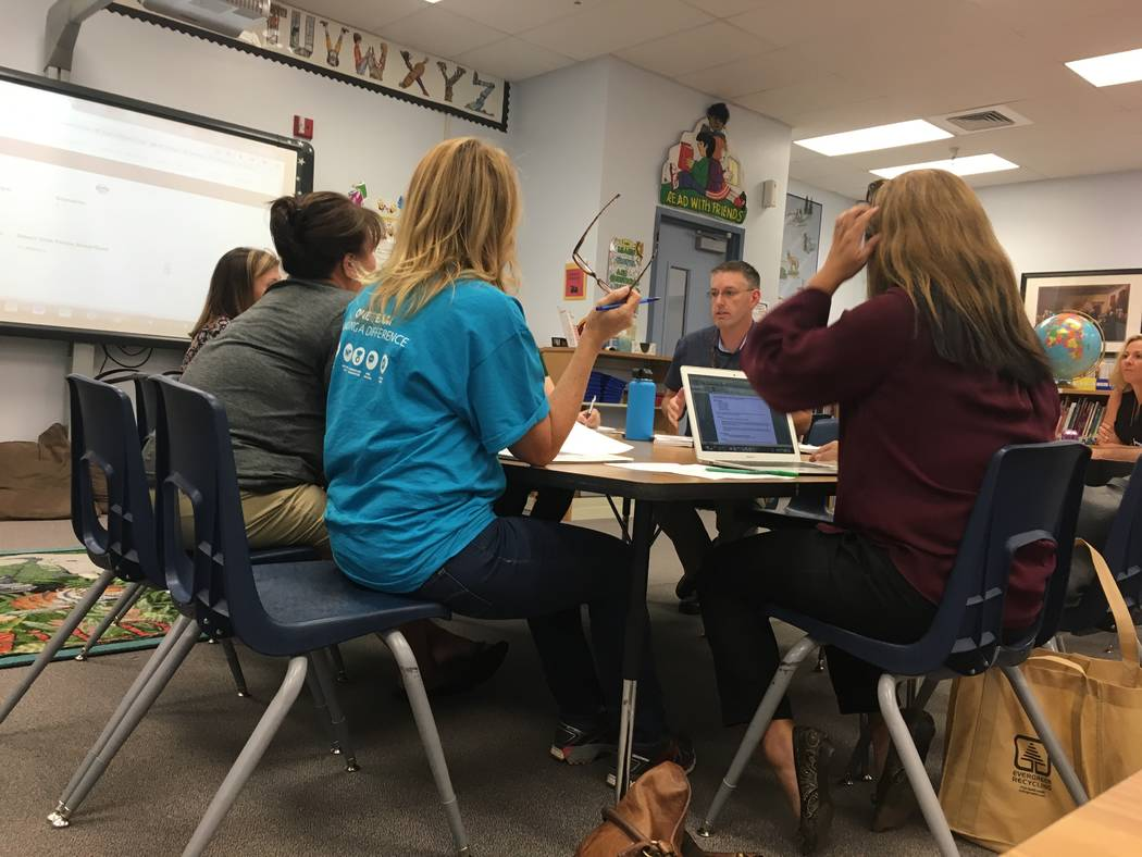 Members of Lamping elementary's SOT listen in as school principal Robert Solomon discusses the formulas used by the district to determine funding at schools. (Diego Mendoza-Moyers/View) @dmendozam ...