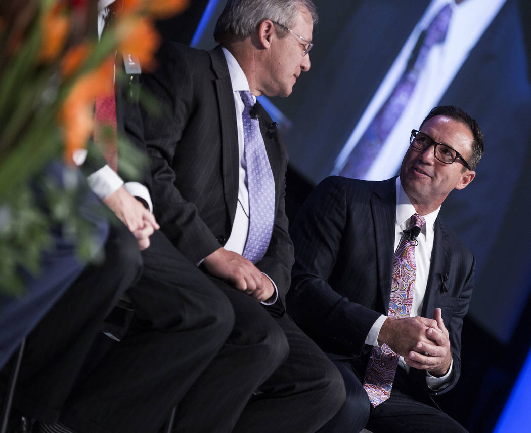 Rivers Casino general manager Craig Clark, left, and vice chairman of the Poarch Band of Creek Indians Robert McGhee partake in a panel discussion featuring gaming leaders at the Special Events St ...