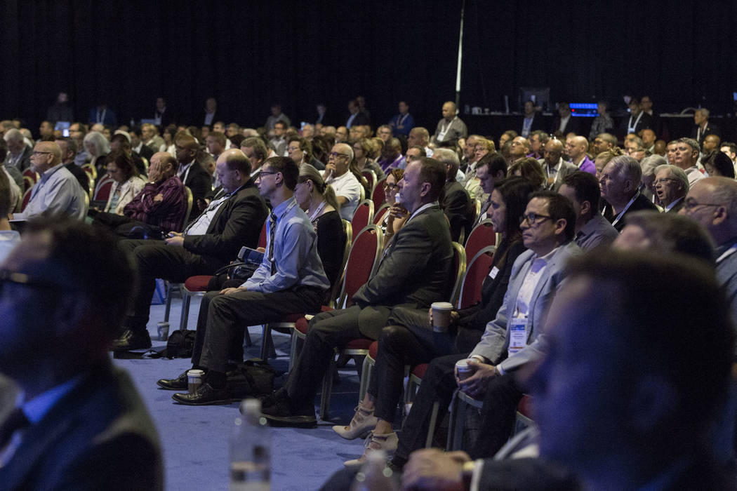 An audience listen to former Boston Police Commissioner Ed Davis give the state of the industry address at the Special Events Stage at the Global Gaming Expo, Tuesday, Oct. 3, 2017. (Elizabeth Bru ...