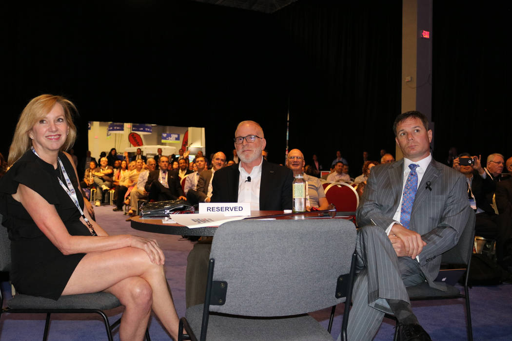 Susan Cartwright, vice president of corporate communications for Scientific Games (left), Scientific Games CEO Kevin Sheehan and Geoff Freeman, president and CEO of the American Gaming Association ...
