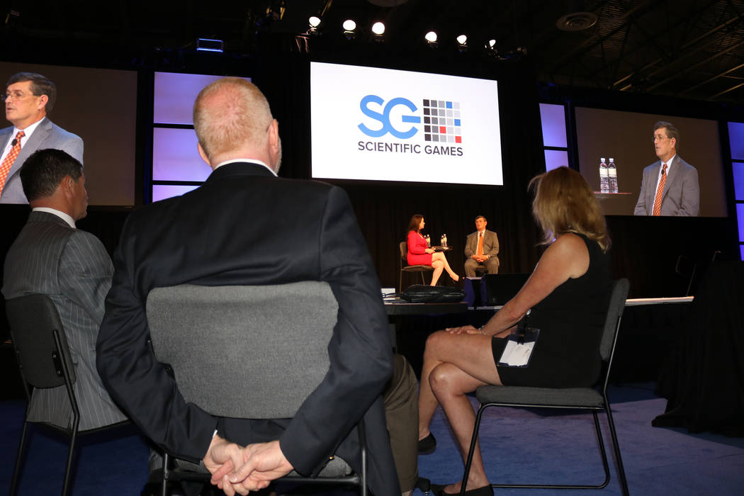 CEO of the American Gaming Association Geoff Freeman (left), Scientific Games CEO Kevin Sheehan and Susan Cartwright, vice president of corporate communications for Scientific Games listen to Dave ...
