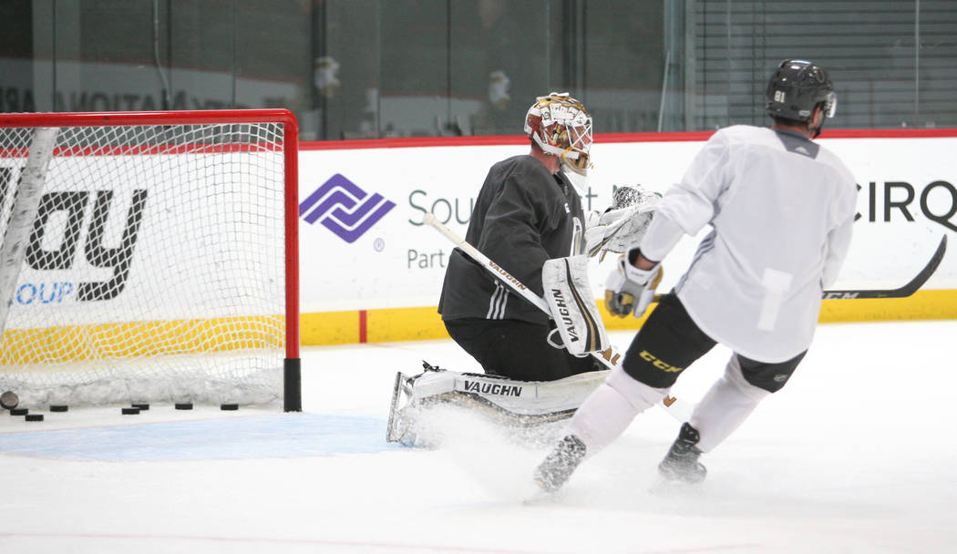 Vegas Golden Knights goalie Calvin Pickard (31), right, looks out to block a shot during the team's practice at City National Arena in Las Vegas, Tuesday, Oct. 3, 2017. Gabriella Benavidez Las Veg ...