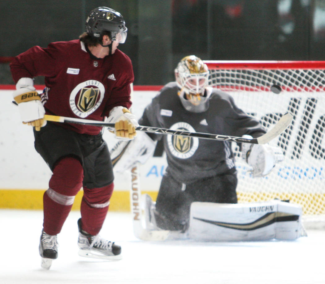 Vegas Golden Knights right wing James Neal (18), left, lines up for a shot against goalie Calvin Pickard (31) during the team's practice at City National Arena in Las Vegas, Tuesday, Oct. 3, 2017. ...