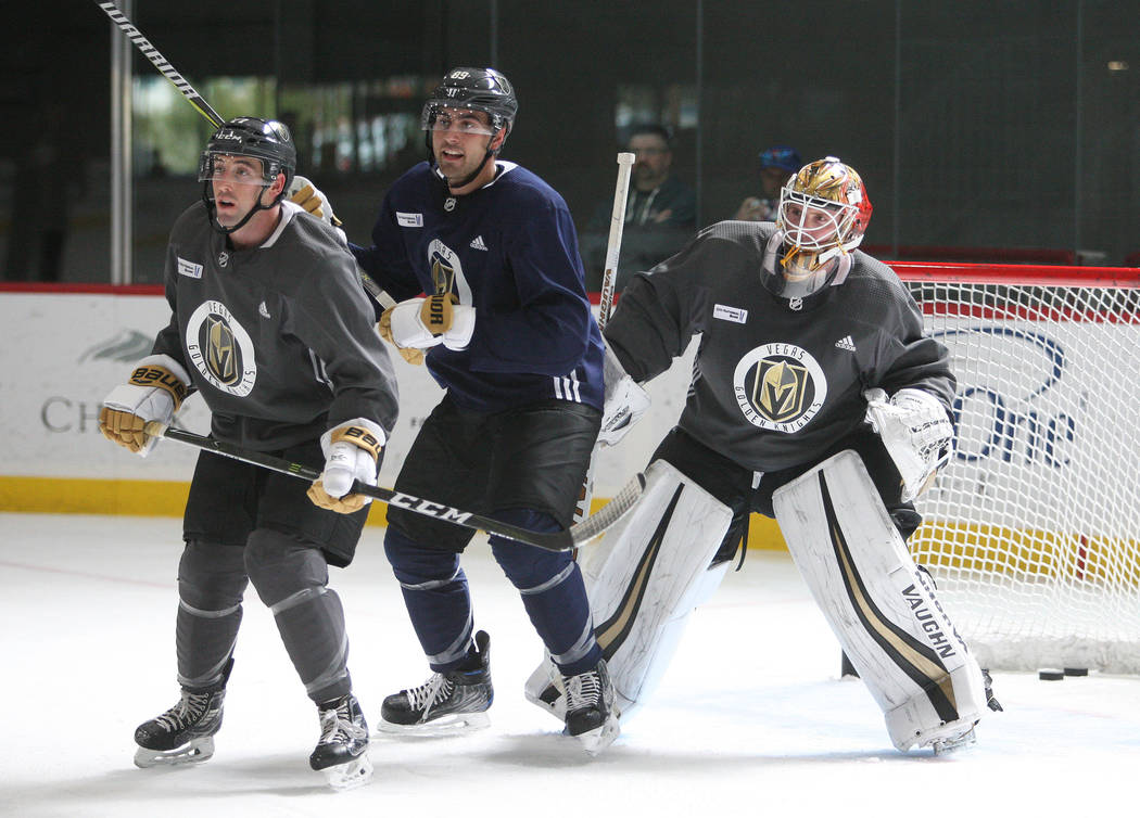From left, Vegas Golden Knights defense Brad Hunt (77), right wing Alex Tuch (89) and goalie Calvin Pickard (31) during the team's practice at City National Arena in Las Vegas, Tuesday, Oct. 3, 20 ...
