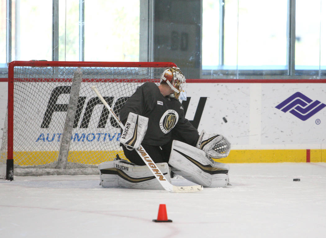 Vegas Golden Knights goalie Calvin Pickard (31) blocks a shot during the team's practice at City National Arena in Las Vegas, Tuesday, Oct. 3, 2017. Gabriella Benavidez Las Vegas Review-Journal @l ...
