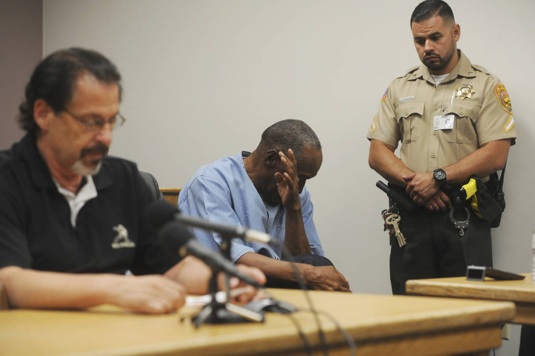 Bruce Fromong testifies for former NFL football star O.J. Simpson, far right, during Simpson's hearing at the Lovelock Correctional Center on Thursday, July 20, 2017.  Fromong, one of the sports m ...
