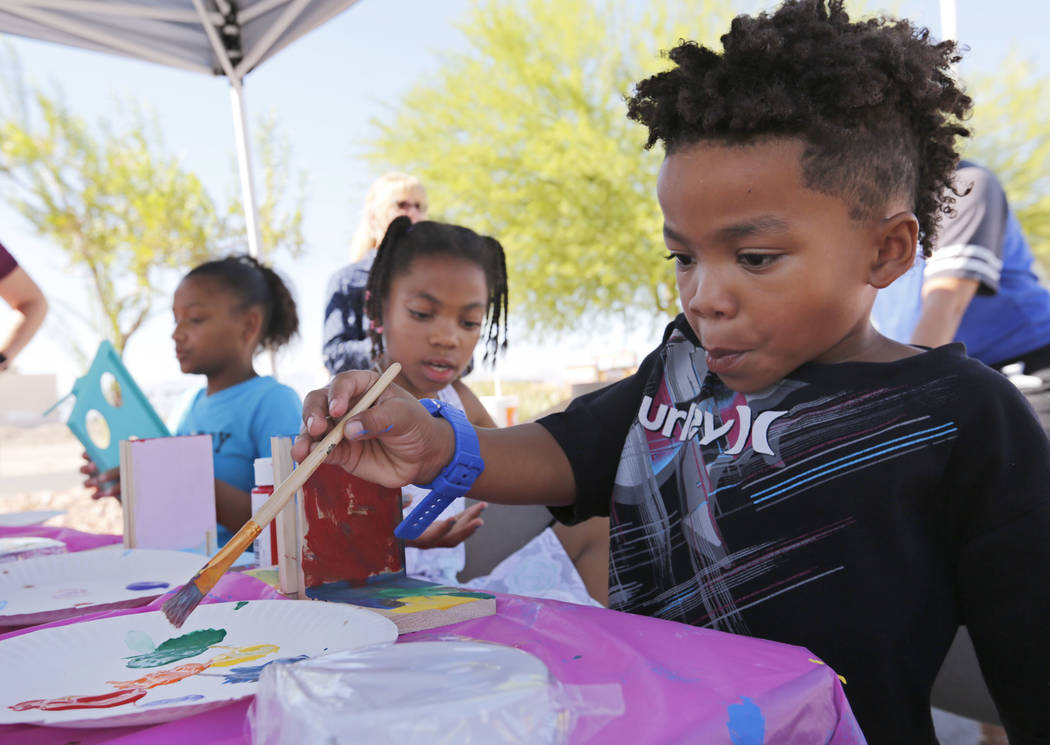 Kelton Jack , 5, right, of Las Vegas makes artwork during a fundraising event for the victims of Hurricanes Harvey and Irma at the Nevada Highway Patrol Southern Command in Las Vegas, Sunday, Oct. ...