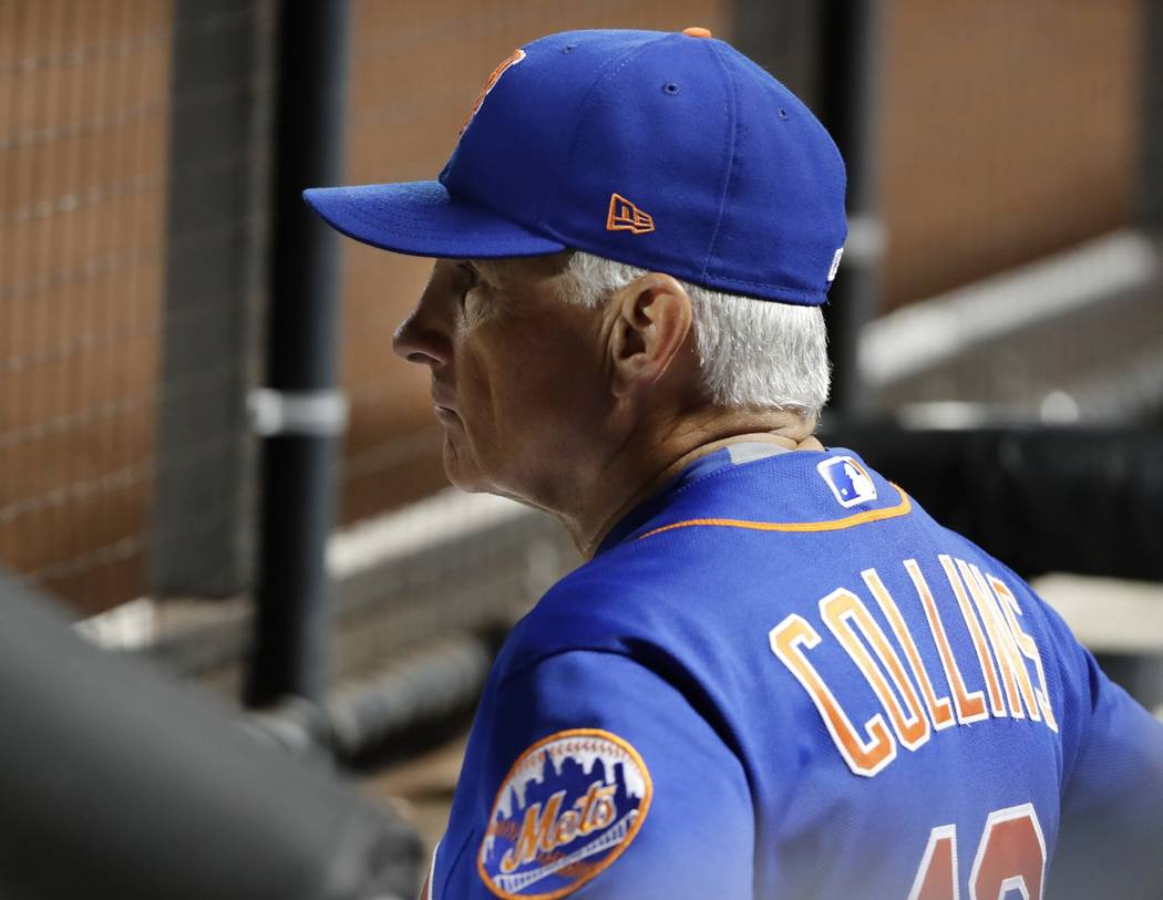 New York Mets manager Terry Collins (10) watches his team take the field before the first inning of the second baseball game of a doubleheader against the Atlanta Braves, Monday, Sept. 25, 2017, i ...
