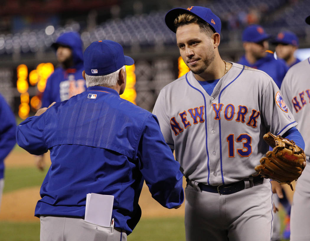 New York Mets' Asdrubal Cabrera, right, shakes hands with manager Terry Collins, left, following the 11th inning of a baseball game against the Philadelphia Phillies, Saturday, Sept. 30, 2017, in  ...