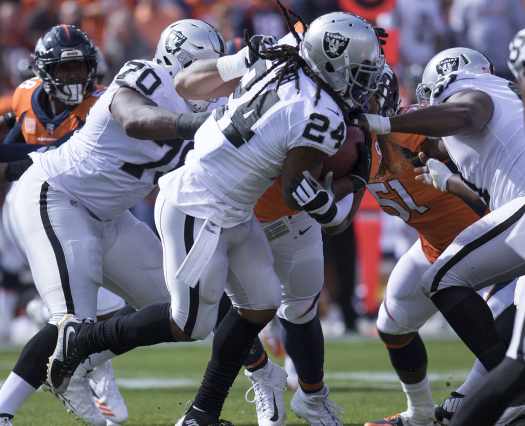 Oakland Raiders running back Marshawn Lynch (24) runs with the football in the first half of their game against the Denver Broncos in Denver, Colo., Sunday, Oct. 1, 2017. Heidi Fang Las Vegas Revi ...