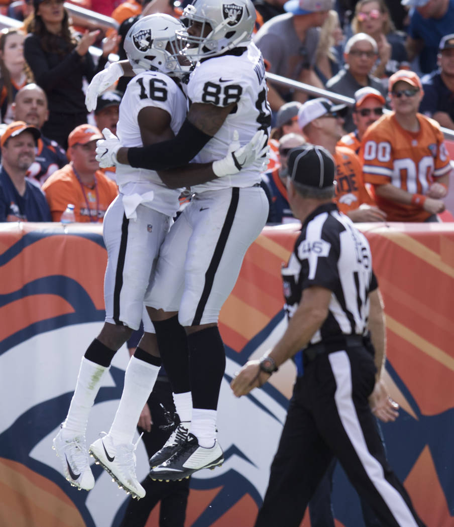 Oakland Raiders wide receiver Johnny Holton (16) celebrates his touchdown with tight end Clive Walford (88) in the first half of their game against the Denver Broncos in Denver, Colo., Sunday, Oct ...