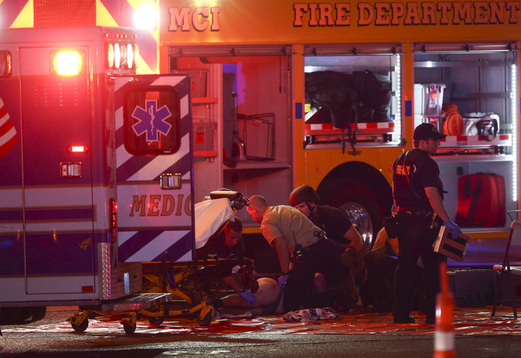 A wounded person is tended to as Las Vegas police respond during an active shooter situation on the Las Vegas Stirp in Las Vegas on Sunday, Oct. 1, 2017. Chase Stevens Las Vegas Review-Journal @cs ...