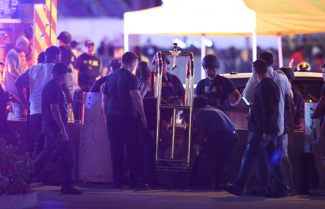 A wounded woman is moved outside of the Tropicana during an active shooter situation on the Las Vegas Stirp in Las Vegas on Sunday, Oct. 1, 2017. Chase Stevens Las Vegas Review-Journal @csstevensphoto