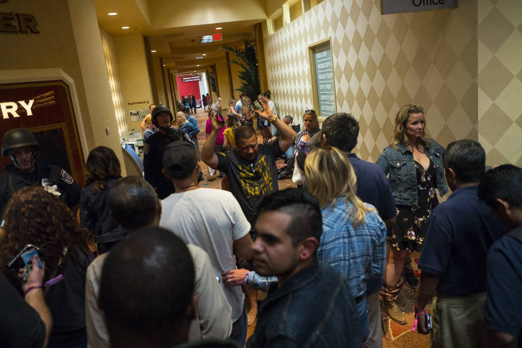 People are searched by Las Vegas police at the Tropicana Las Vegas during an active shooter situation on the Las Vegas Stirp in Las Vegas on Sunday, Oct. 1, 2017. Chase Stevens Las Vegas Review-Jo ...