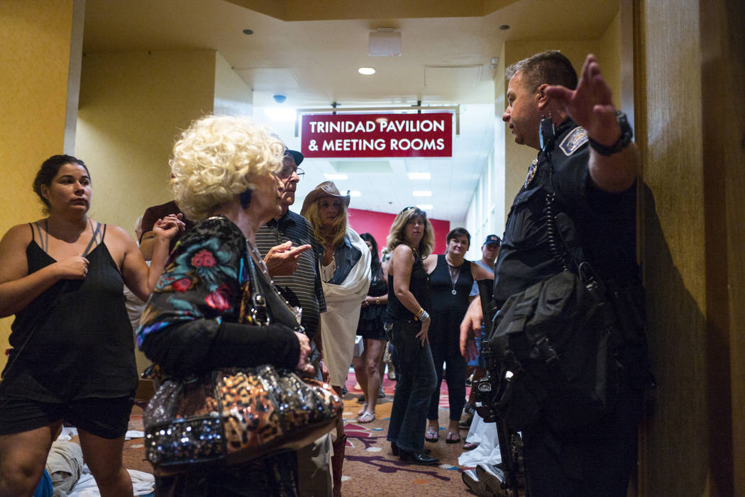 A police officer directs people at the Tropicana Las Vegas following an active shooter situation that left 50 dead and over 200 injured on the Las Vegas Strip during the early hours of Monday, Oct ...