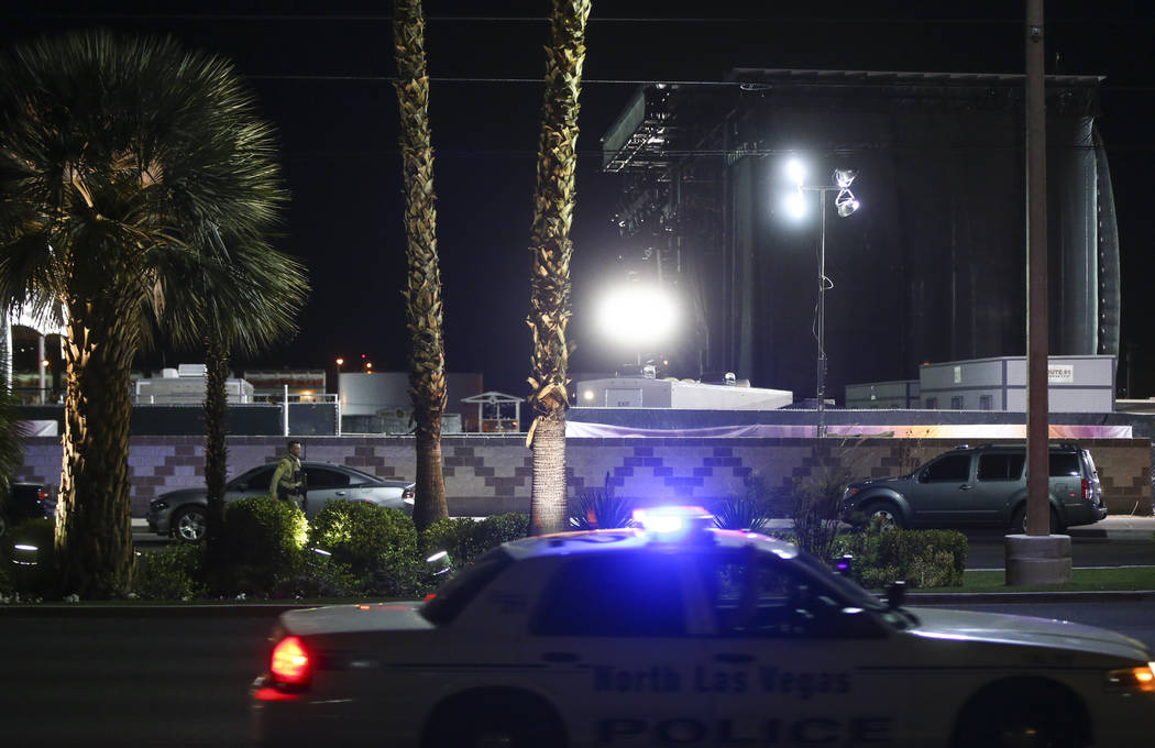 Festival grounds for Route 91 rise in the background as Las Vegas police investigate following an active shooter situation that left 50 dead and over 200 injured on the Las Vegas Strip during the  ...