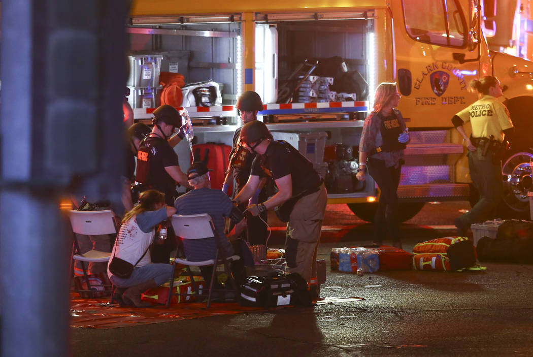 Medics treat the wounded as Las Vegas police respond during an active shooter situation on the Las Vegas Strip on Sunday, Oct. 1, 2017. Chase Stevens Las Vegas Review-Journal @csstevensphoto