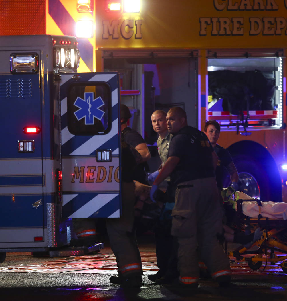 A body is loaded into an ambulance by emergency workers as Las Vegas police respond during an active shooter situation on the Las Vegas Strip on Sunday, Oct. 1, 2017. Chase Stevens Las Vegas Revie ...