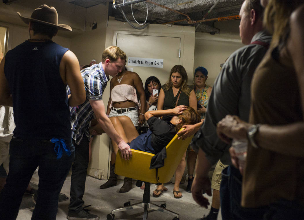 People assist a wounded woman at the Tropicana Las Vegas during an active shooter situation on the Las Vegas Strip on Sunday, Oct. 1, 2017. Chase Stevens Las Vegas Review-Journal @csstevensphoto