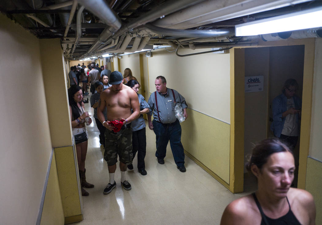 People wait in employee hallways as the Tropicana Las Vegas goes on lockdown during an active shooter situation on the Las Vegas Strip on Sunday, Oct. 1, 2017. Chase Stevens Las Vegas Review-Journ ...