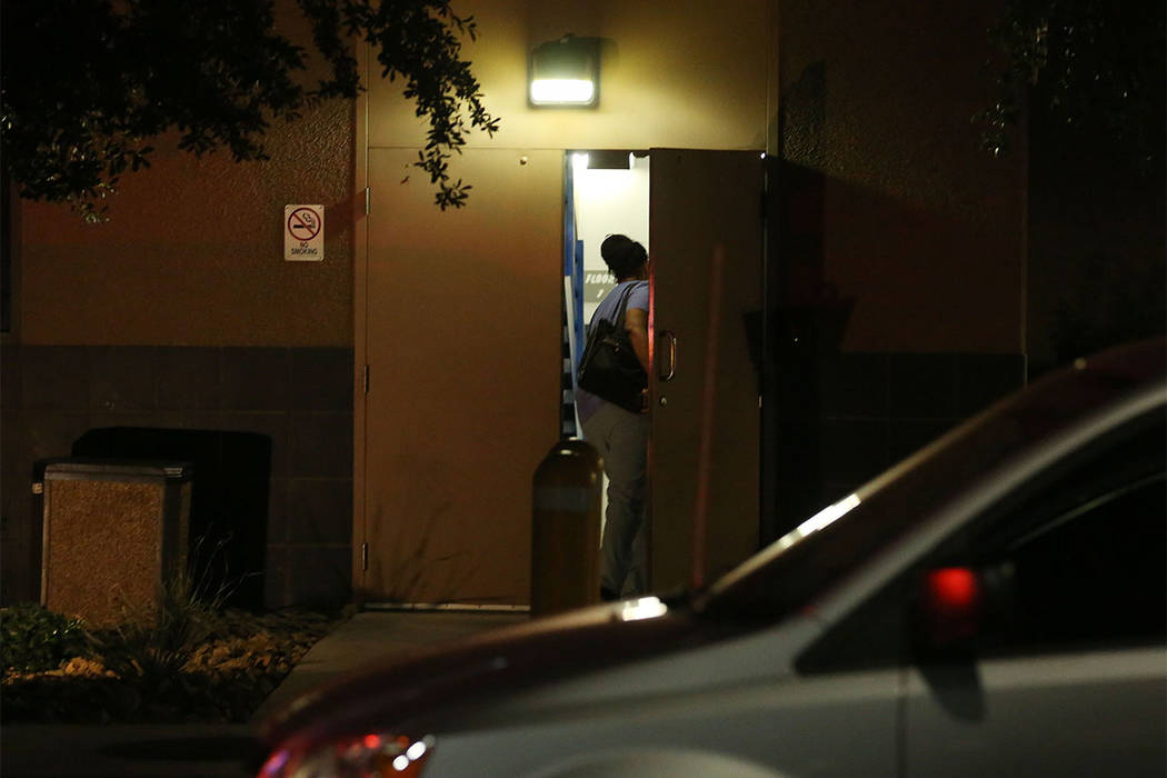 A staff member in scrubs enters the back of University Medical Center's Trauma Center on Charleston Boulevard in Las Vegas, Sunday, Oct. 1, 2017. (Bridget Bennett/Las Vegas Review-Journal) @Bridge ...