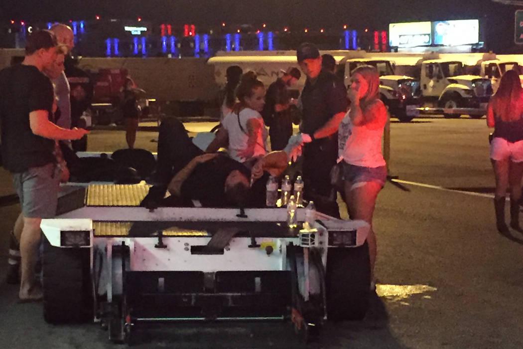 A man waits at the Las Vegas executive airport t