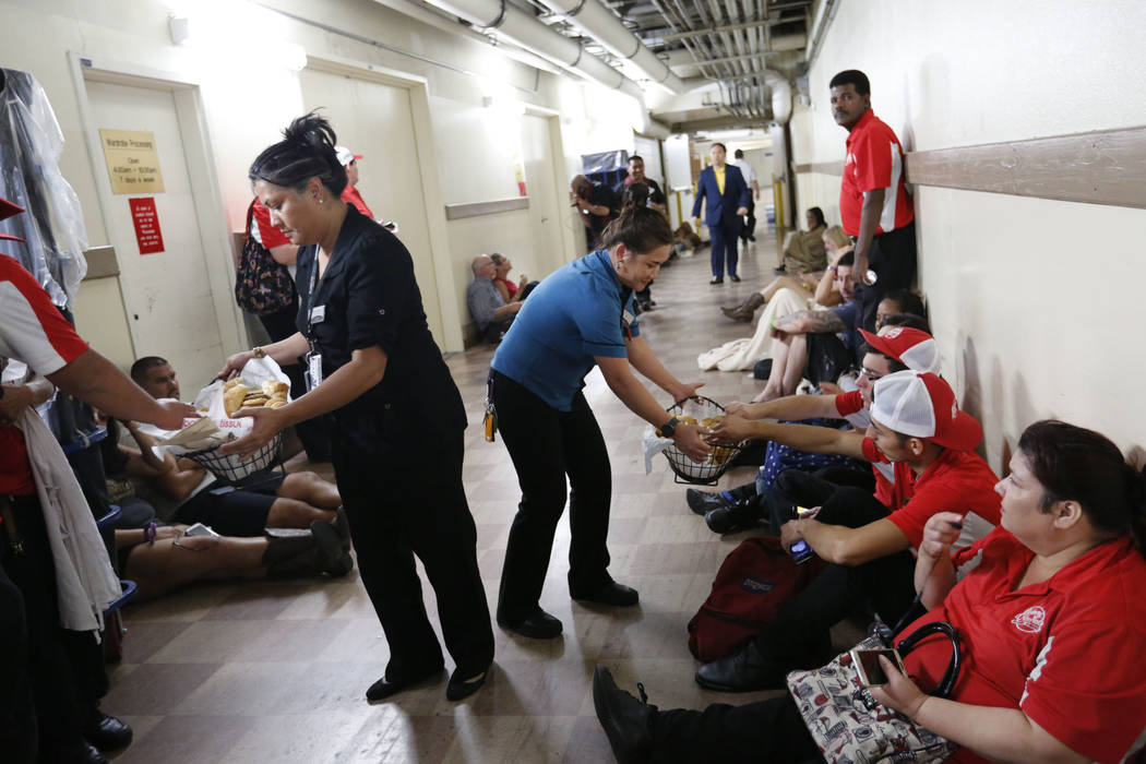 Luxor staff members bring bread to the evacuees during a shooting, Monday Oct. 2, 2017, in Las Vegas. People have been evacuated in the basement at the Luxor.  Chitose Suzuki Las Vegas Review-Journal