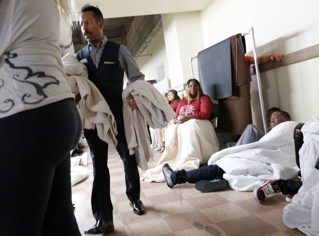A Luxor staff member brings blankets to the evacuees at the baseman of the Luxor during a shooting, Monday, Oct. 2, 2017, in Las Vegas. Chitose Suzuki Las Vegas Review-Journal