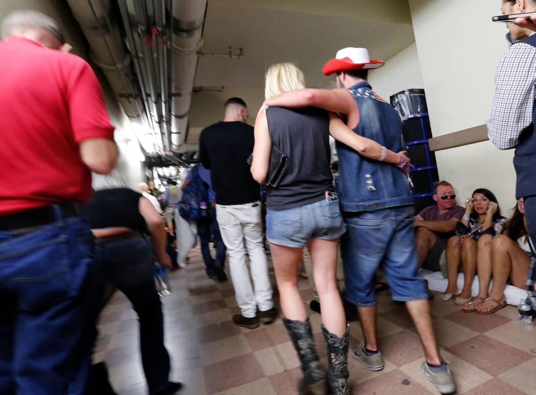 People evacuate to the Luxor during a shooting, Sunday, Oct. 1, 2017, in Las Vegas. Chitose Suzuki Las Vegas Review-Journal