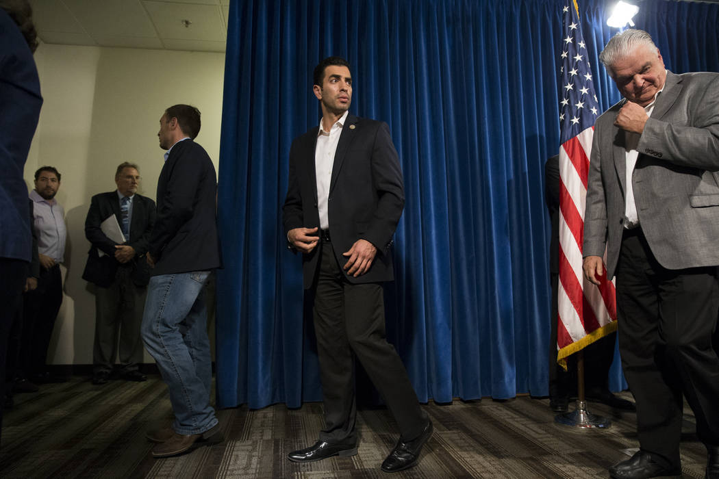 U.S. Rep. Ruben Kihuen, D-Nev., left, and Clark County Commissioner Steve Sisolak following a press conference on the mass shooting, at the Las Vegas Metropolitan Police Department headquarters in ...