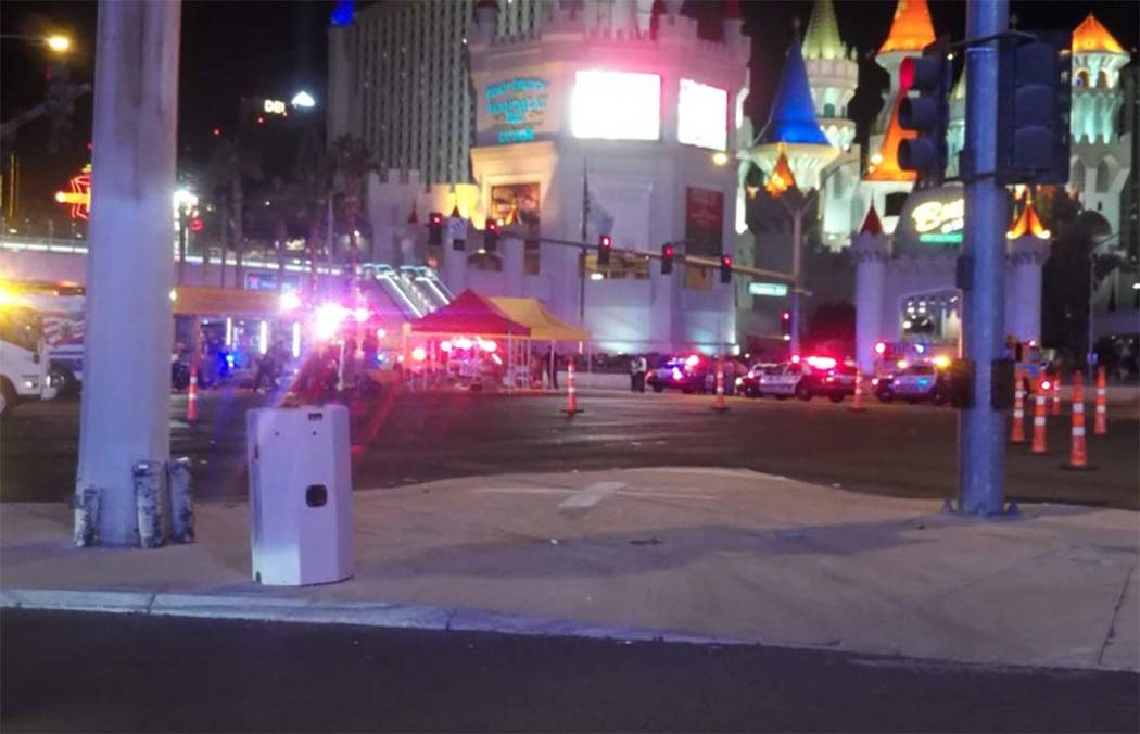 Las Vegas police converge at the corner of Tropicana Avenue and Las Vegas Boulevard.