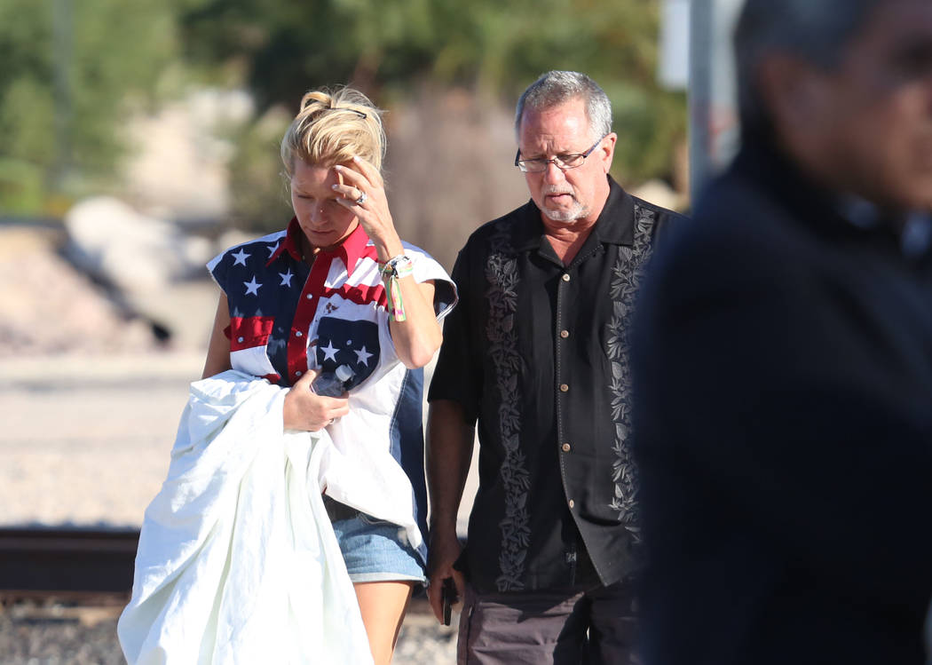 Kathy Boggio-Mocnik, left, and her husband Gary, both of Aliso Viejo, Calif., return to Mandalay Bay hotel-casino on Monday, Oct. 2, 2017 where at least 58 people were killed and more than 400 oth ...