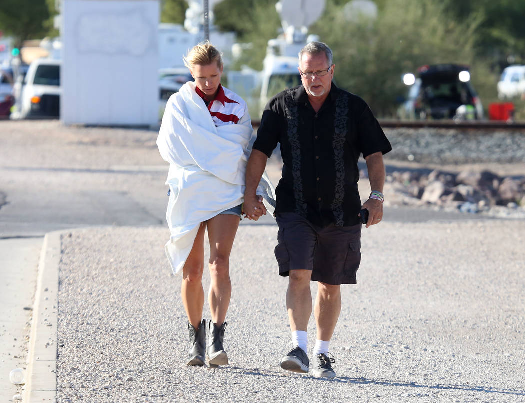Kathy Boggio-Mocnik and her husband Gary, both of Aliso Viejo, Calif., return to Mandalay Bay hotel-casino on Monday, Oct. 2, 2017 where at least 58 people were killed and more than 400 others wer ...
